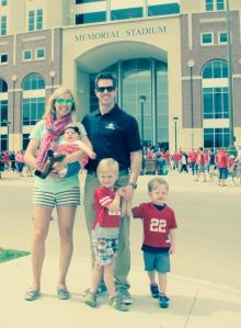 family in front of stadium