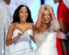 LAS VEGAS, NV - JANUARY 15: Miss America 2010 Caressa Cameron (L) prepares to crown Teresa Scanlan, Miss Nebraska, the new Miss America during the 2011 Miss America Pageant at the Planet Hollywood Resort & Casino January 15, 2011 in Las Vegas, Nevada. (Photo by Ethan Miller/Getty Images) Original Filename: GYI0063061136.jpg